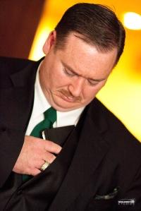 Mr. Green pocketing Dr. Black's journal